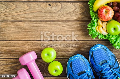 istock Fitness, healthy and active lifestyles Concept, dumbbells, sport shoes,  smartphone 691551406