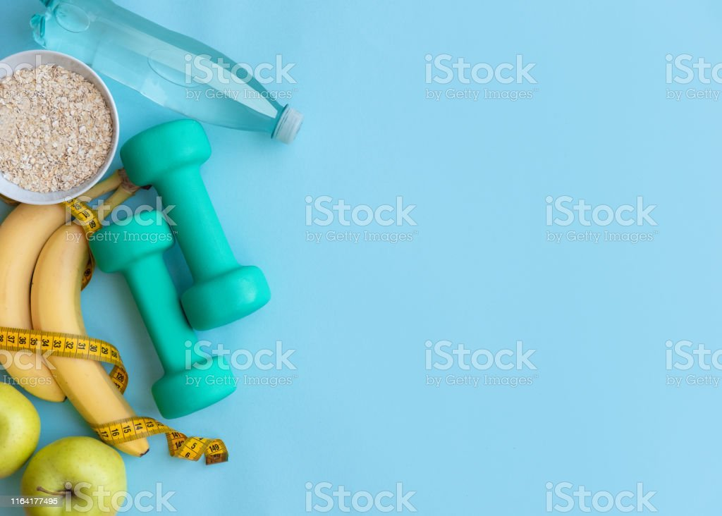 Fitness, healthy and active lifestyles Concept on blue background...