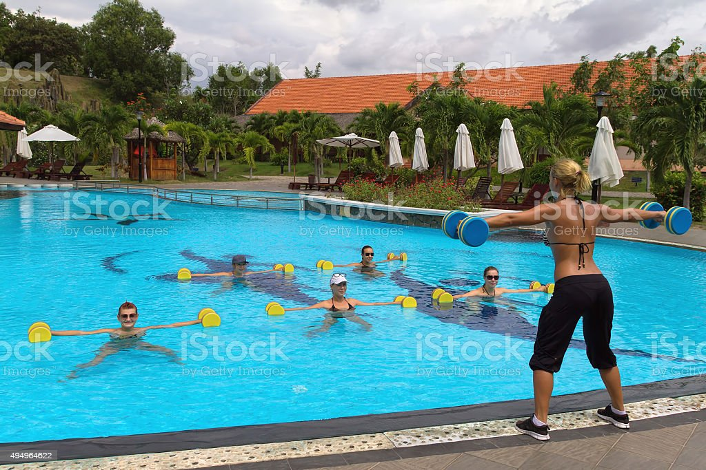 Fitness instructor in front of a group of people stock photo