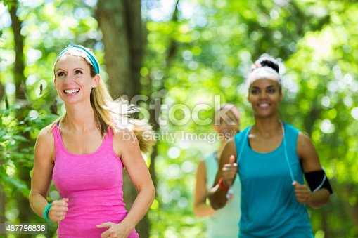 1051098428 istock photo Fitness instructor leading club of runners outdoors 487796836