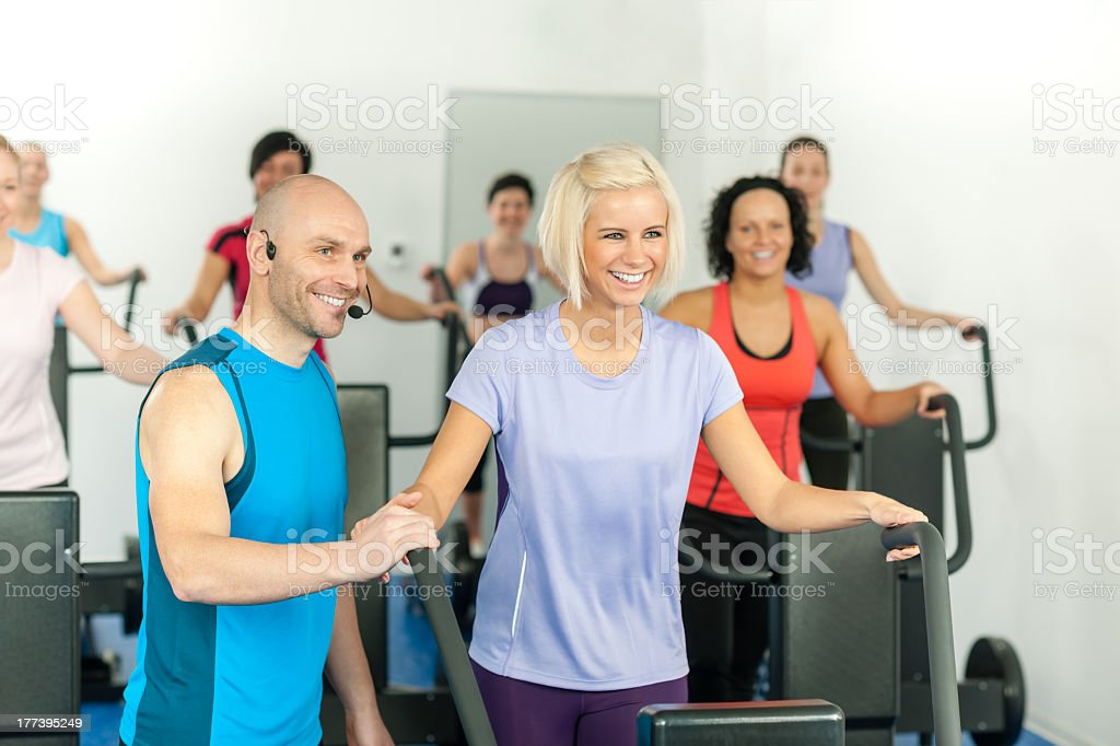 Fitness instructor leading gym people exercise royalty-free stock photo