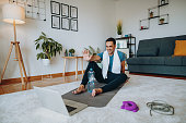 istock Fitness instructor resting after training at home - online training with client 1281947223