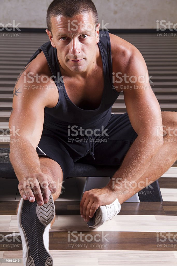 Fitness instructor stretching leg royalty-free stock photo
