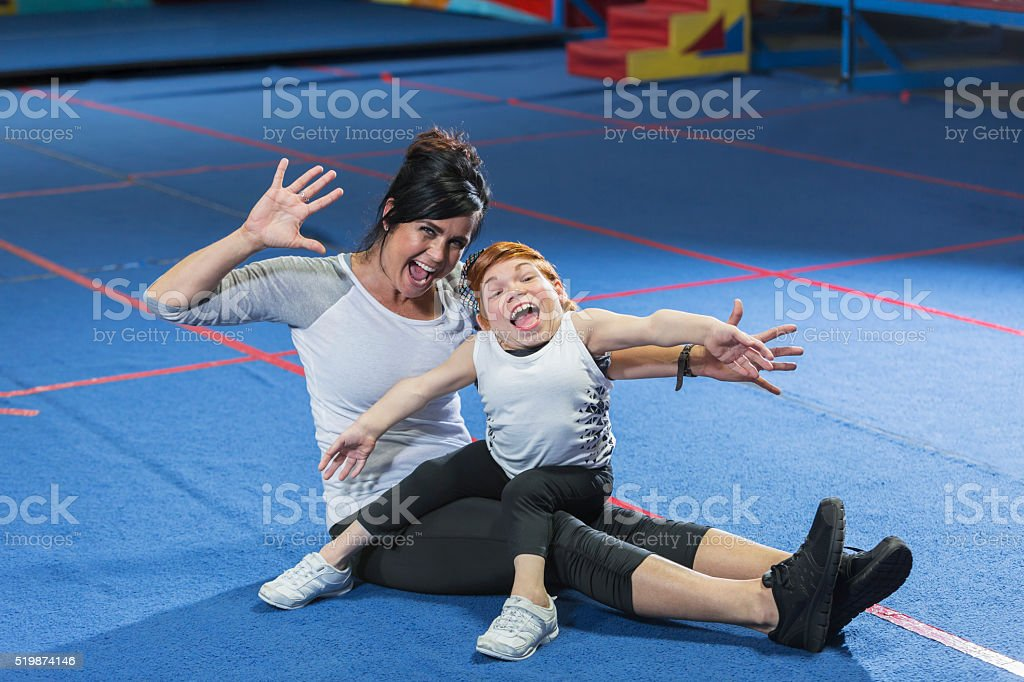 Fitness instructor working with special needs woman stock photo
