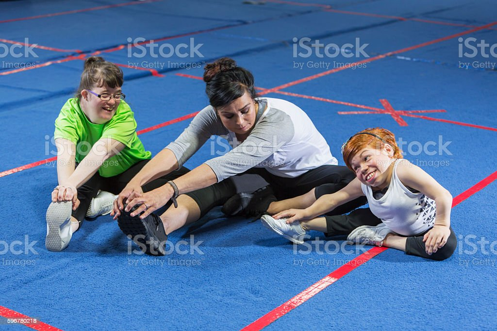 Fitness instructor working with special needs women stock photo