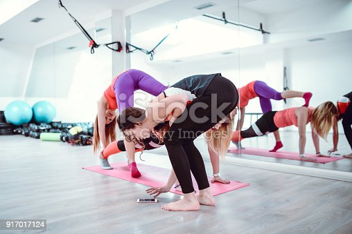 914755448 istock photo Fitness Instructors Helps and Motivates One Overweight Female Student 917017124