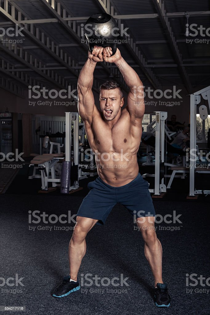 Fitness Kettlebells swing exercise man workout stock photo