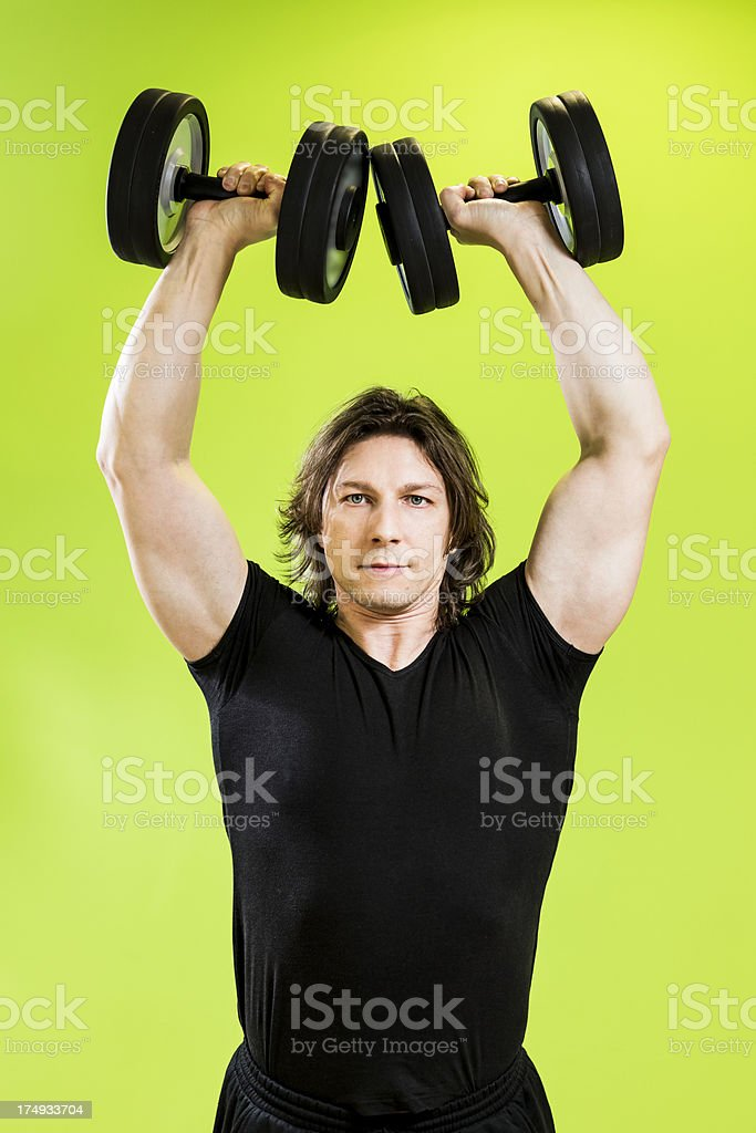 Fitness Man doing exercise with dumbbell royalty-free stock photo