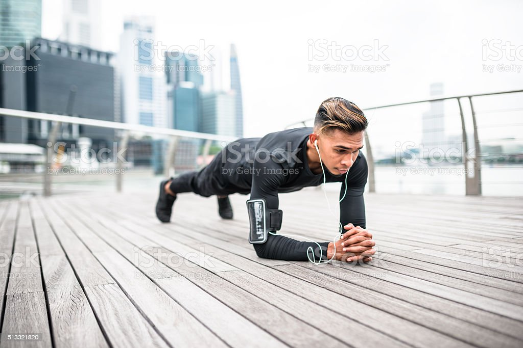 Fitness man doing plank position stock photo