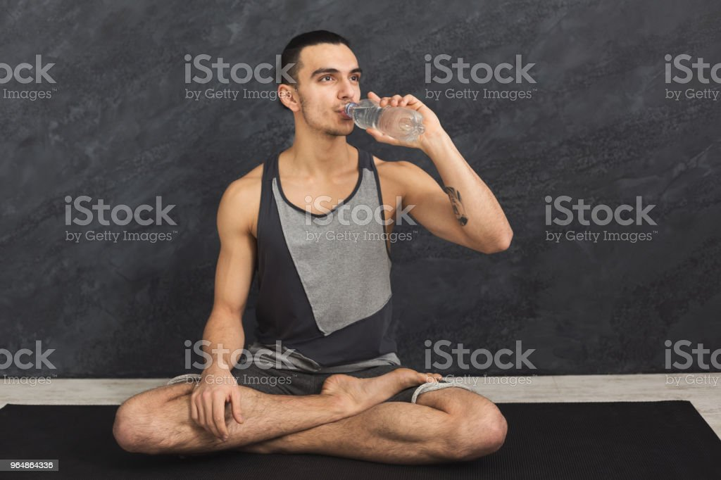 Fitness man drinking water at gym royalty-free stock photo