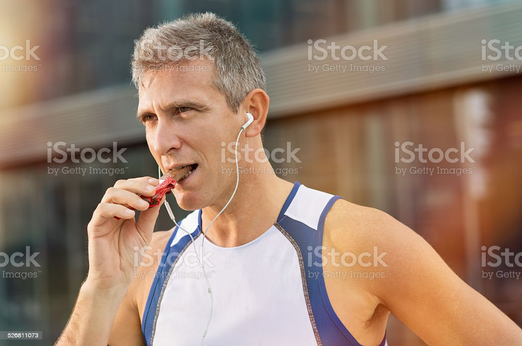 Fitness Man Eating Snack Food stock photo