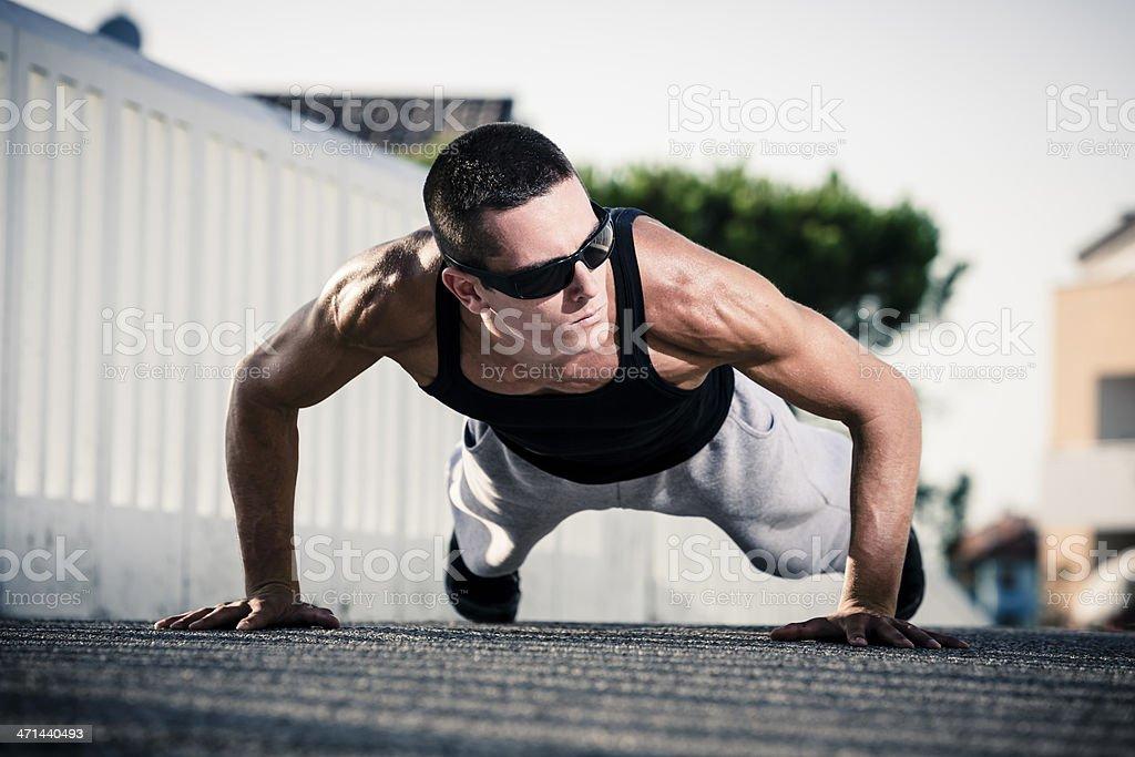 Fitness man exercising push ups royalty-free stock photo