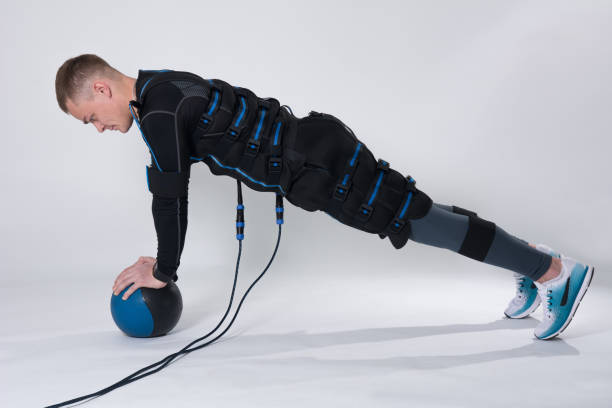Fitness man in an electric stimulation suit stock photo