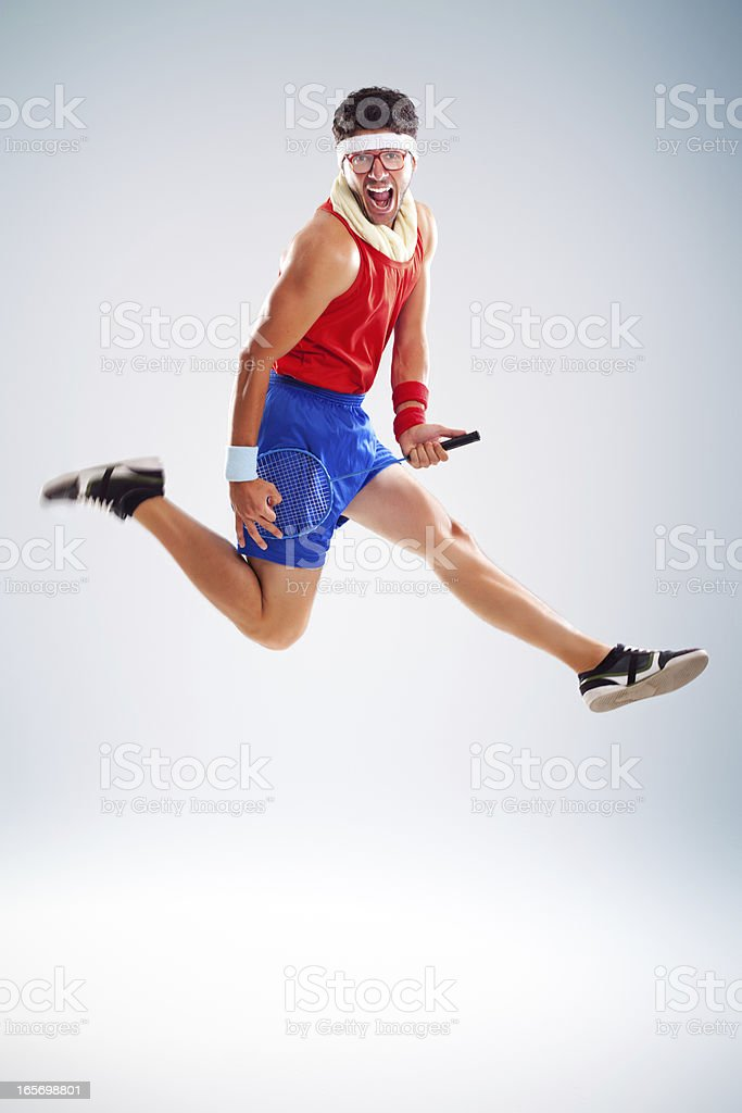 Fitness man jumping with tennis racket royalty-free stock photo