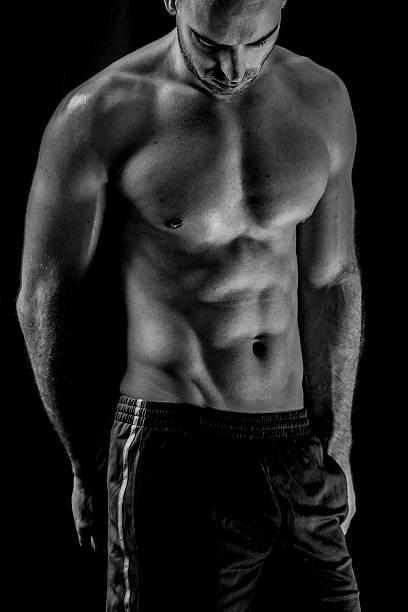 fitness mann - männliche körperkunst stock-fotos und bilder