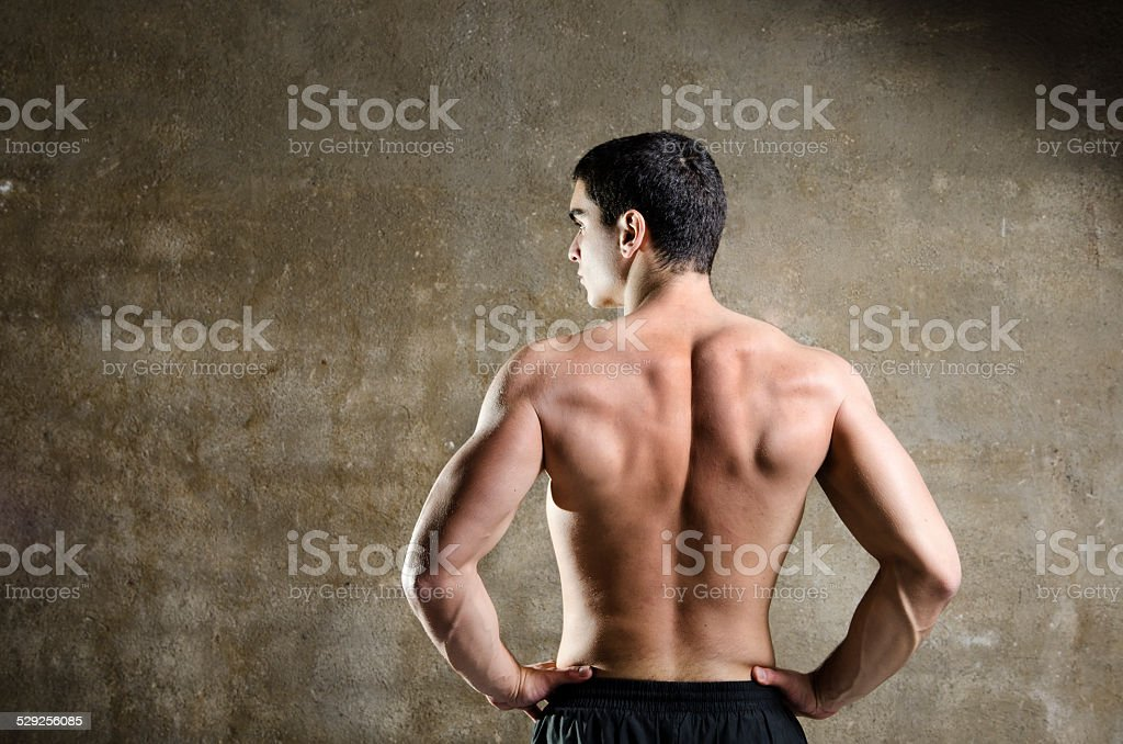 Fitness man posing with naked torso stock photo