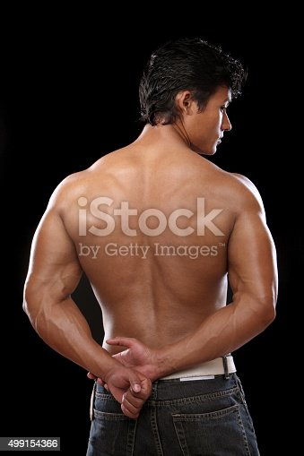 618638418istockphoto Fitness man showing his back 499154366