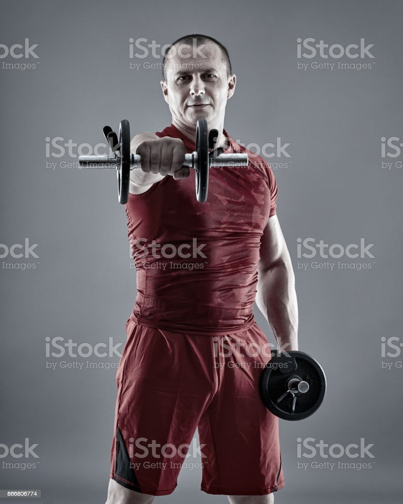 Fitness man training delts stock photo