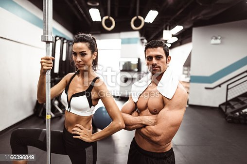 610237160istockphoto fitness man weightlifting in the gym 1166396849