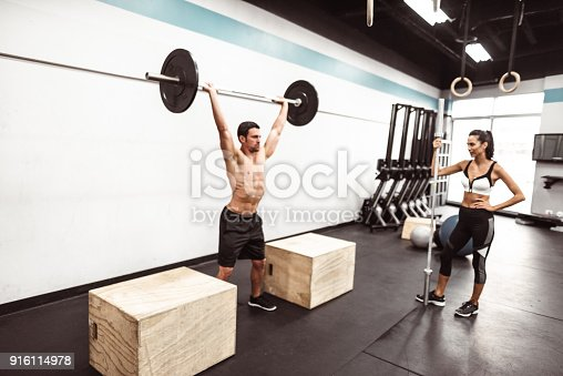 610237160 istock photo fitness man weightlifting in the gym 916114978