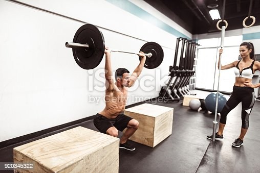 610237160 istock photo fitness man weightlifting in the gym 920345322