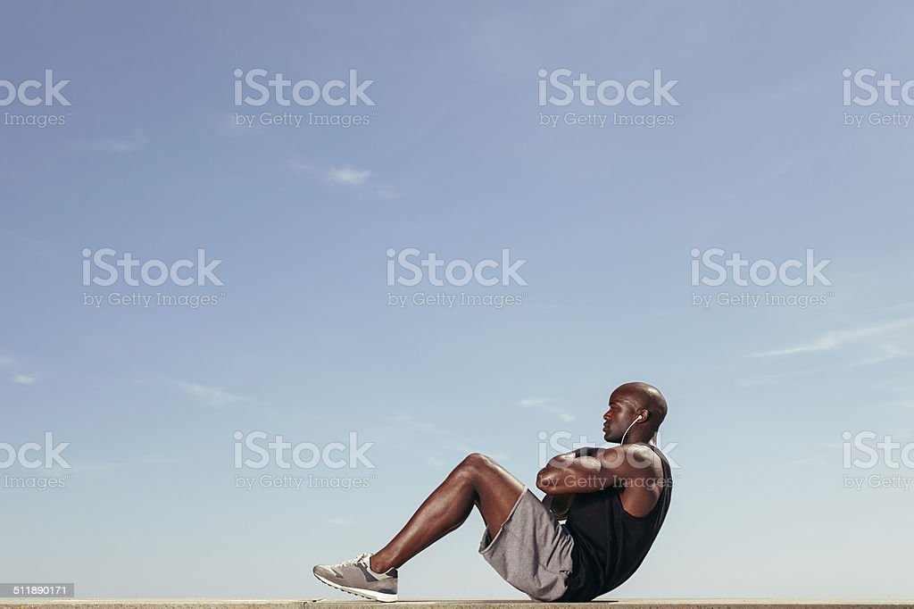 Fitness model doing crunches stock photo