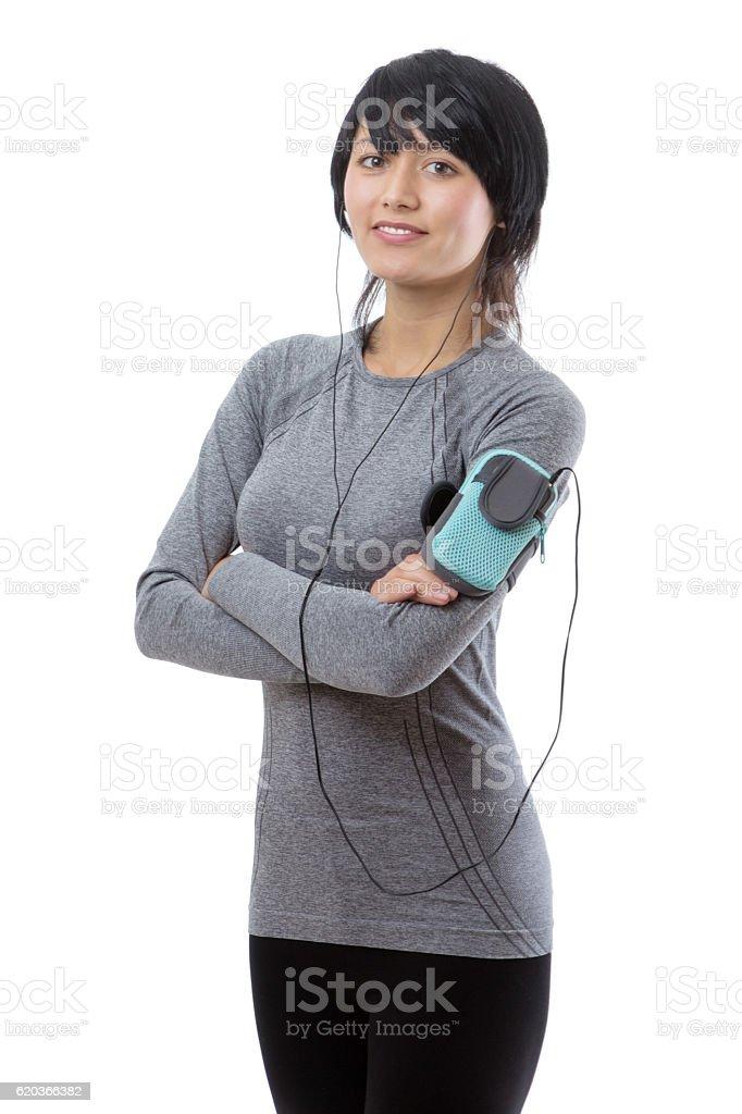 fitness model listening to music zbiór zdjęć royalty-free