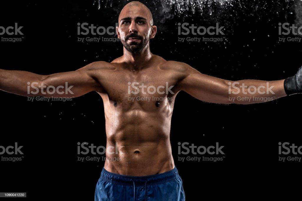 Fitness model mma fighter excercising shot on black studio background...