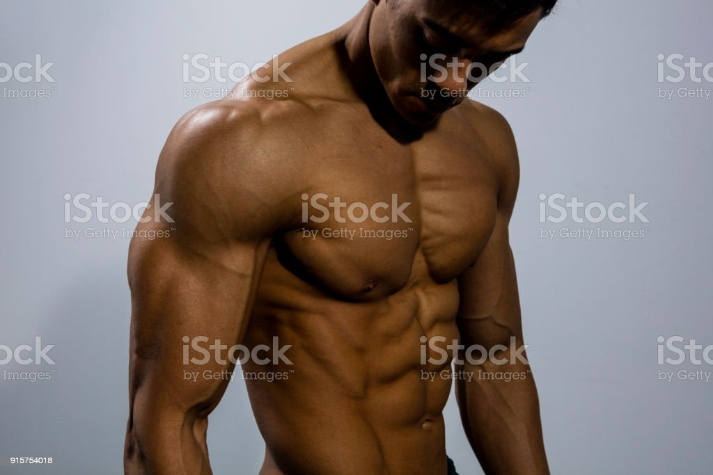 Fitness Model Torso With Pectoral Muscles Flexed Stock Photo More
