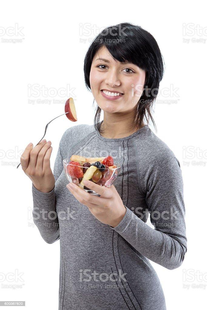 Fitness model with fruit salad zbiór zdjęć royalty-free