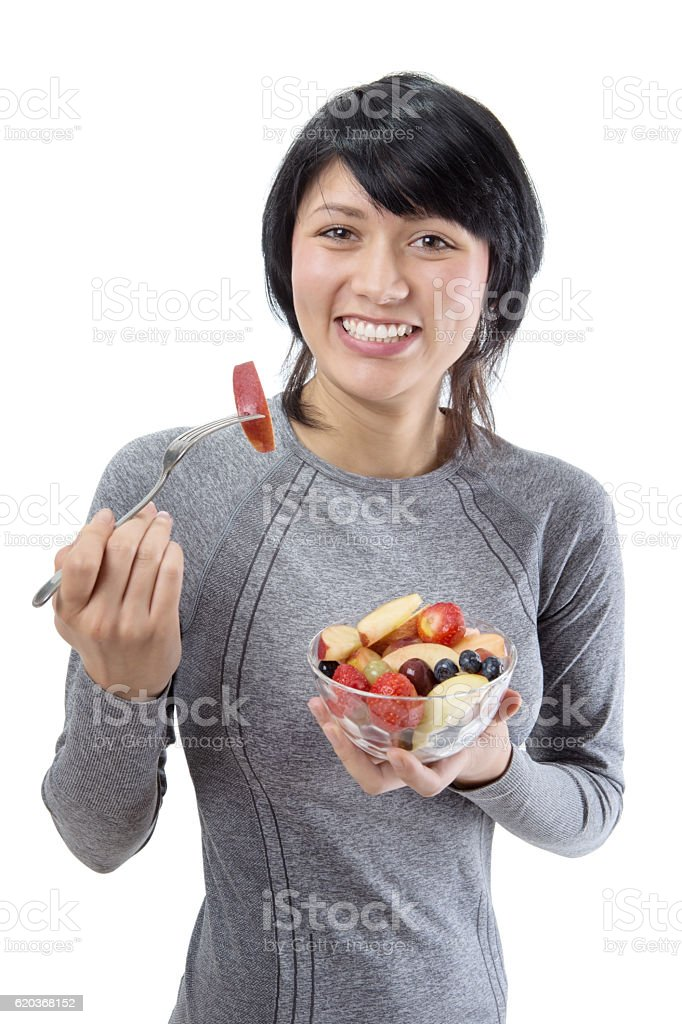 Fitness model with fruit salad foto de stock royalty-free