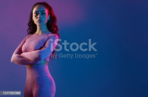 Fitness model woman front of colorful background.