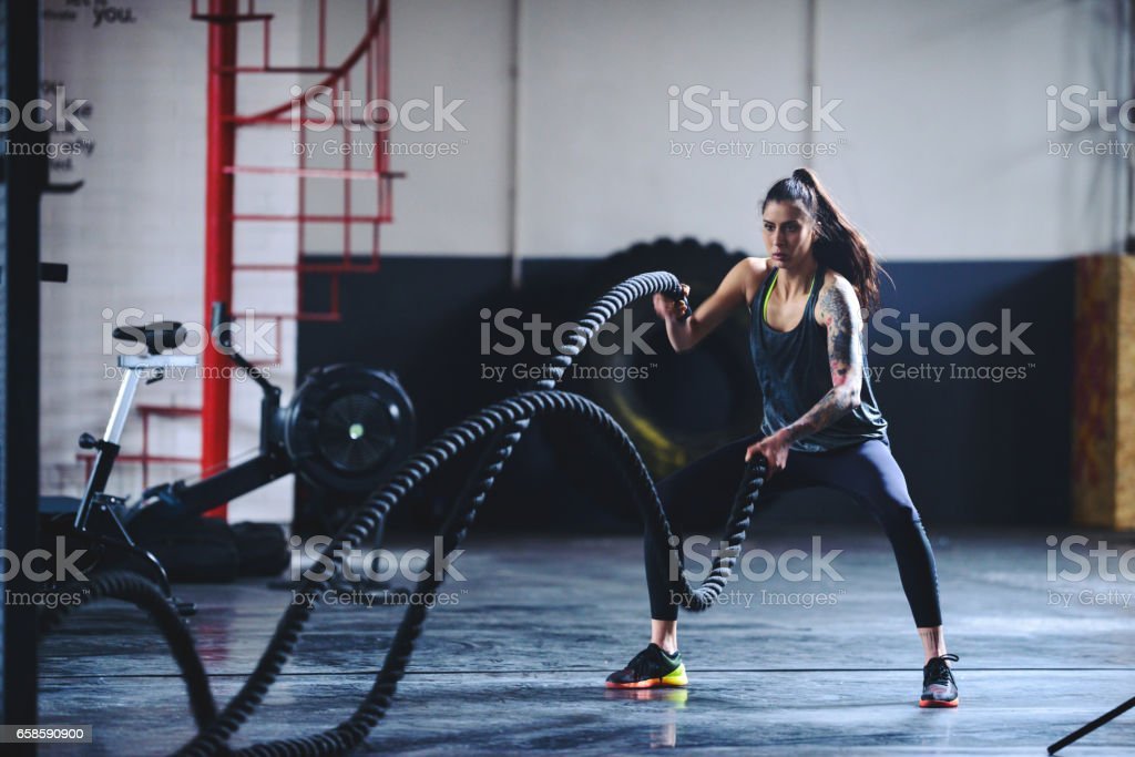 Fitness on the ropes stock photo