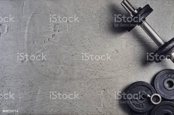 Fitness or bodybuilding background dumbbells on gym floor top view picture id908224714?b=1&k=6&m=908224714&s=612x612&h=wr7xt14cgbmrwxs7z0bzl5zcbraapth2l9rgymcdw y=