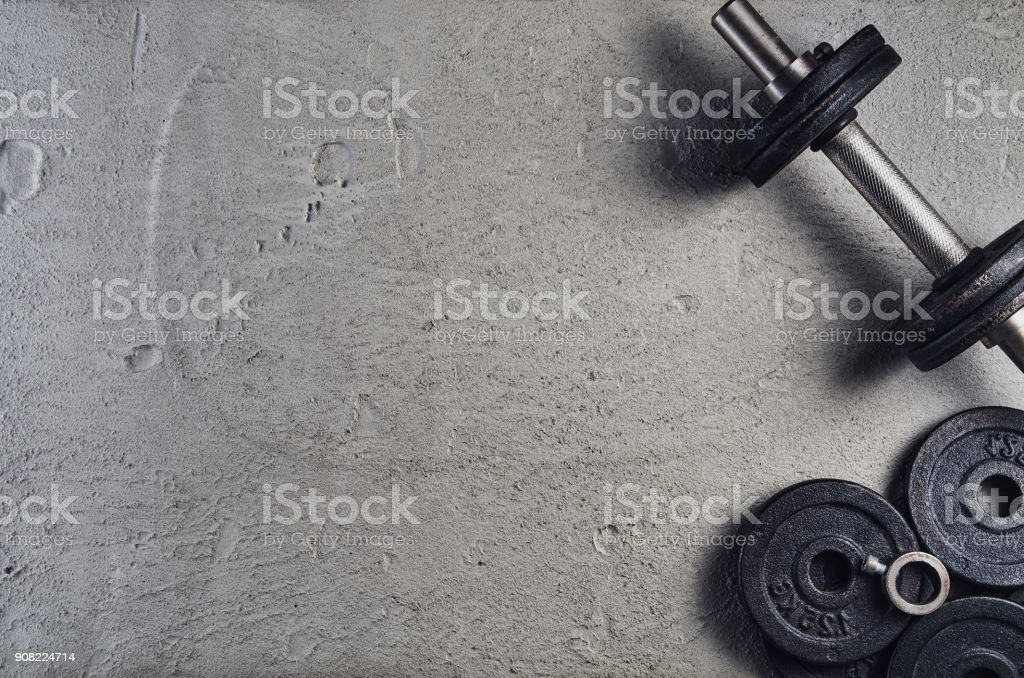 Fitness or bodybuilding background. Dumbbells on gym floor, top view stock photo