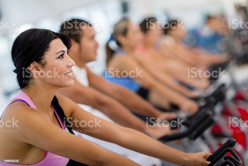 Fitness people in spinning class royalty-free stock photo