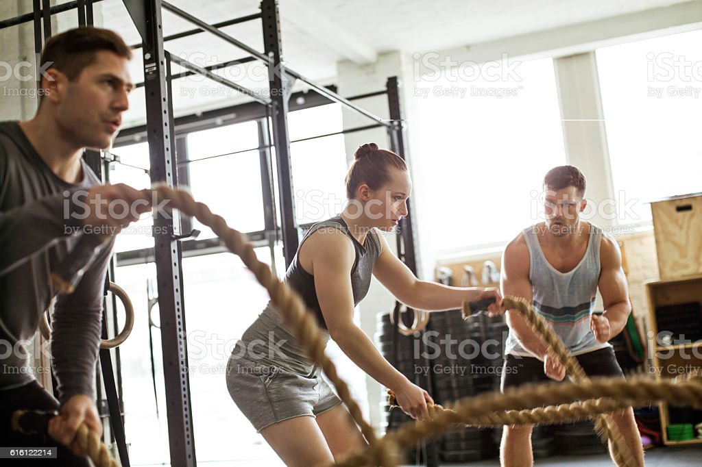 fitness people working out with battle ropes 3人のストックフォトや