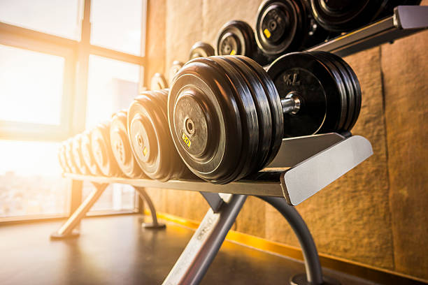 fitness room in the morning - weights stock photos and pictures