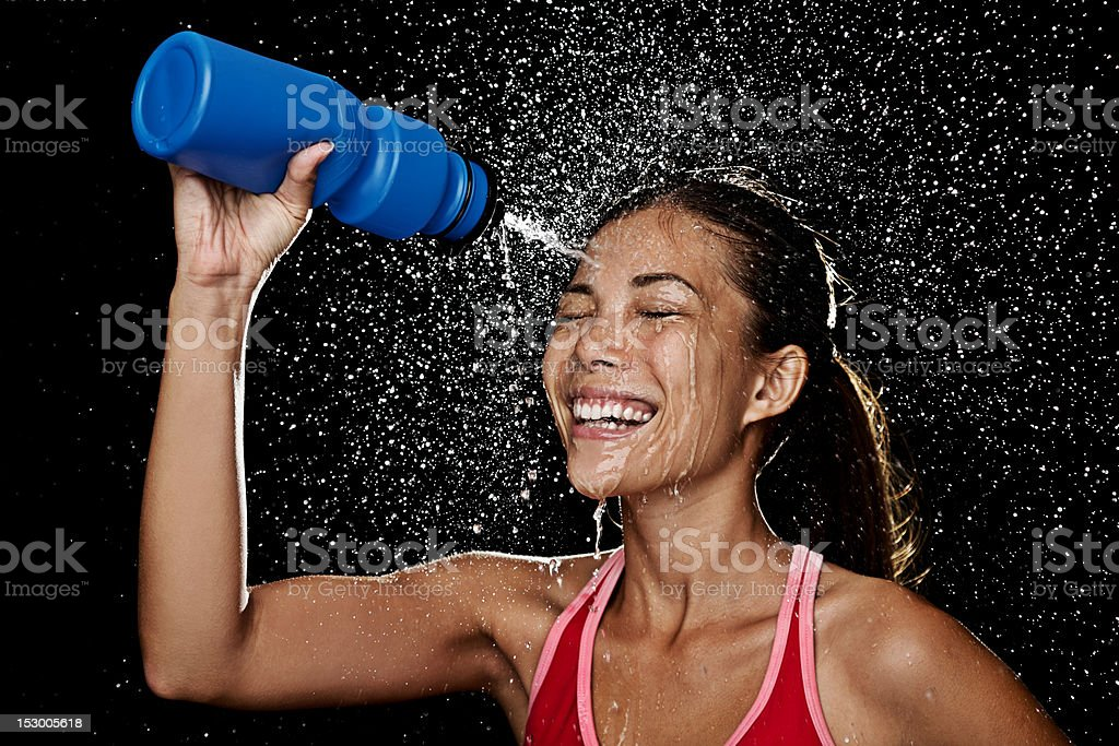 Fitness runner woman drinking royalty-free stock photo