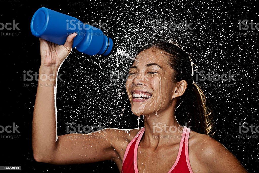 Fitness runner woman drinking stock photo