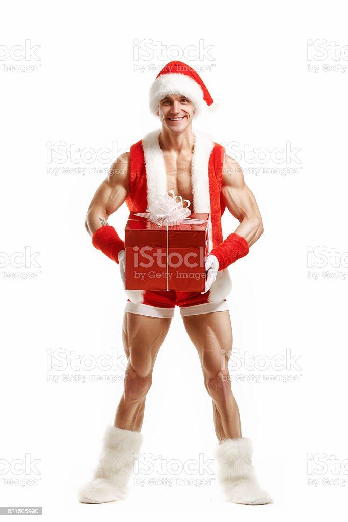 Fitness Santa Claus holding a red box photo libre de droits