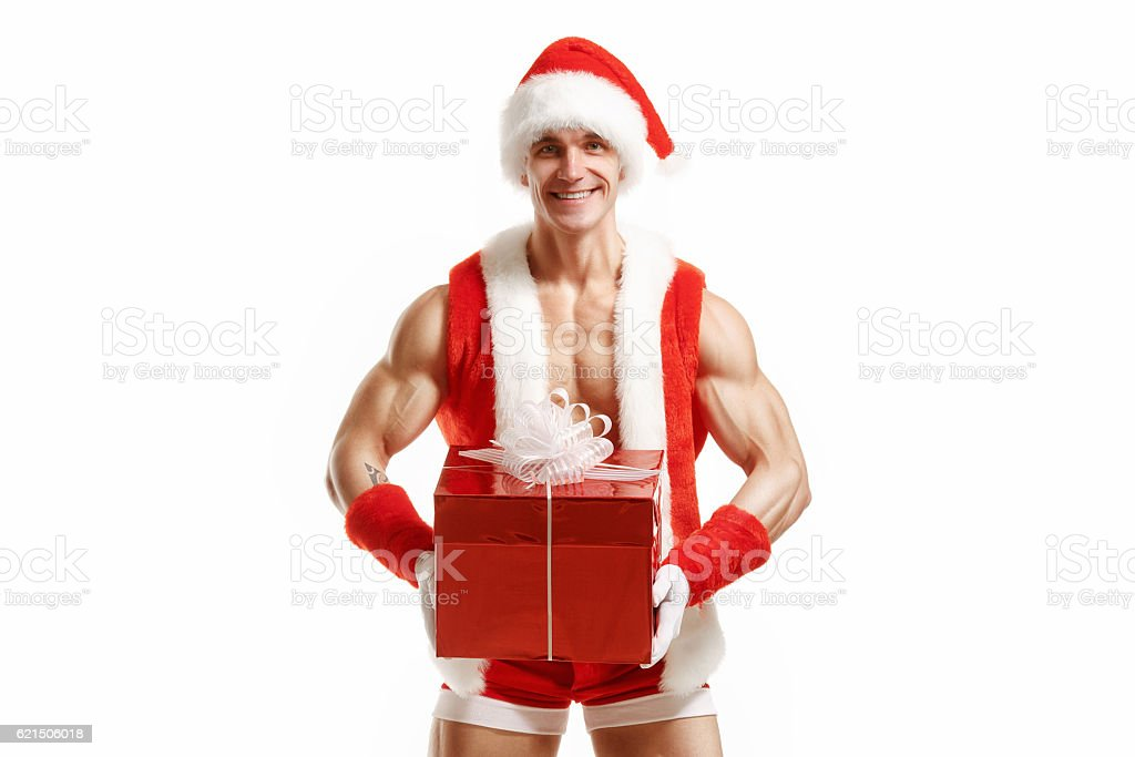 Fitness Santa Claus holding a red box foto stock royalty-free