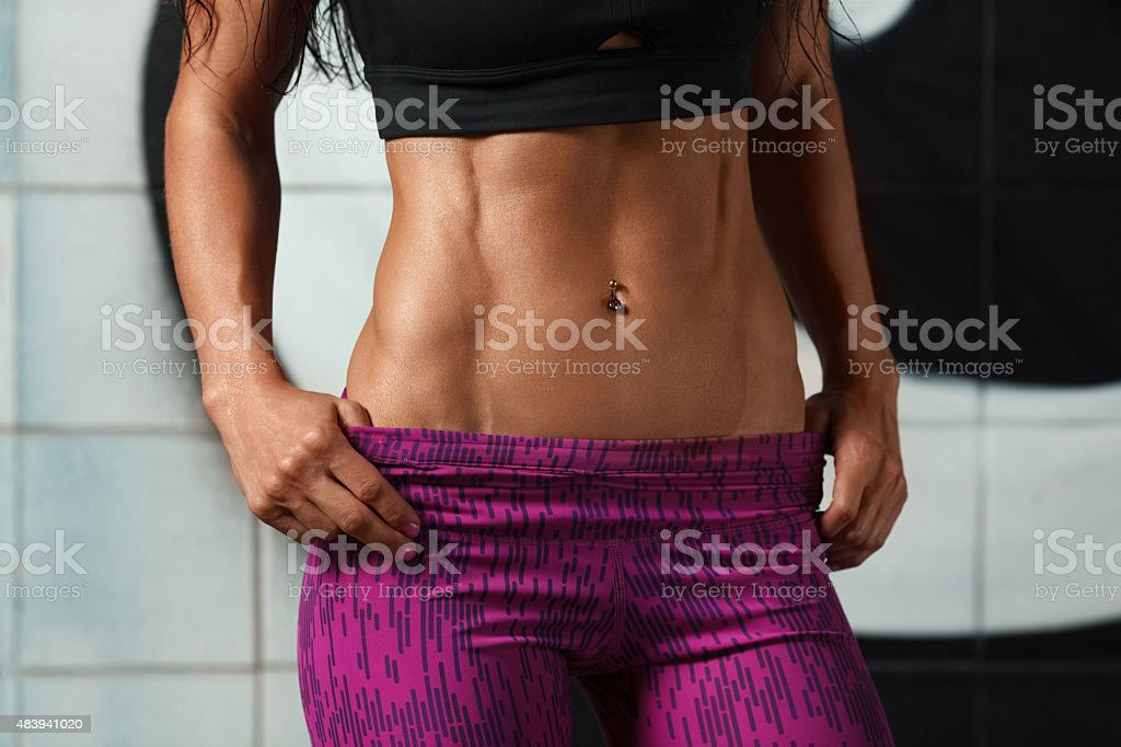 Fitness sexy woman showing abs and flat belly. muscular girl stock photo