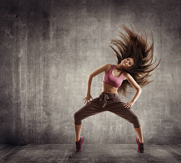 Fitness Sport Dance, Woman Dancer Flying Hair Dancing on Concrete stock photo