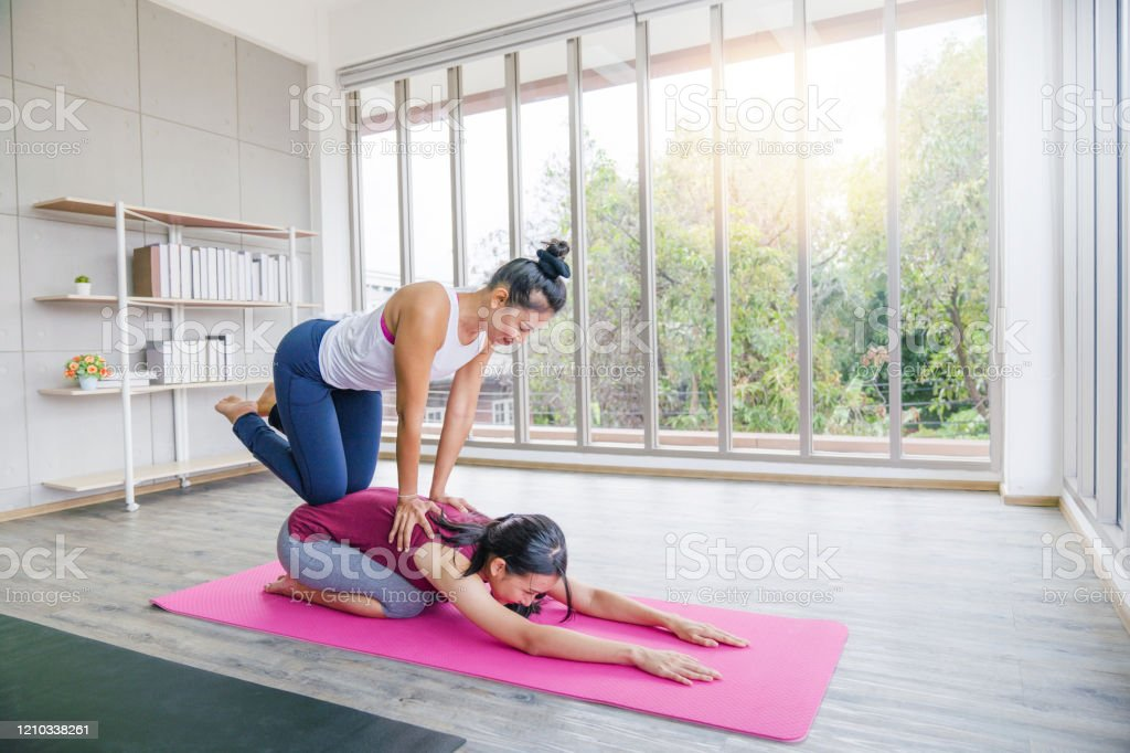 Fitness Stretching Practice Yoga Teacher With Student Working Out In Sports Club Instructor Helping Female Student With Positioning On Her Yoga Pose In Class Stock Photo Download Image Now Istock