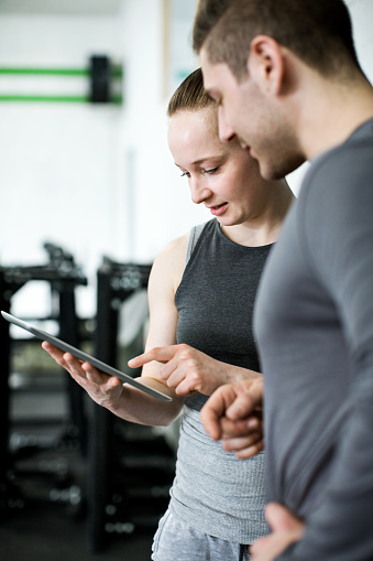 860045834 istock photo Fitness trainer discussing workout plan with client 641794310