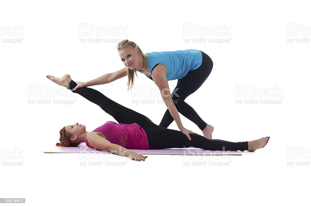fitness trainer help woman exercise stretch royalty-free stock photo