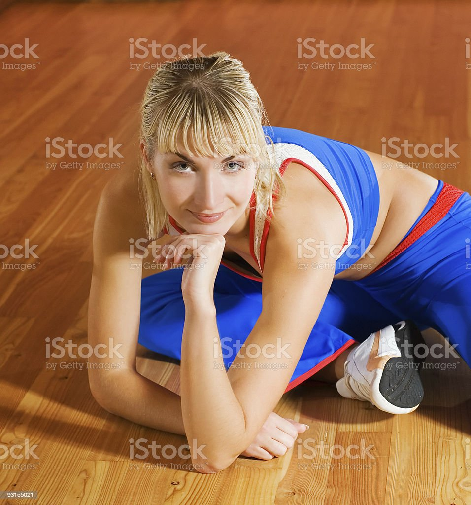 Fitness trainer relaxing after exercise royalty-free stock photo