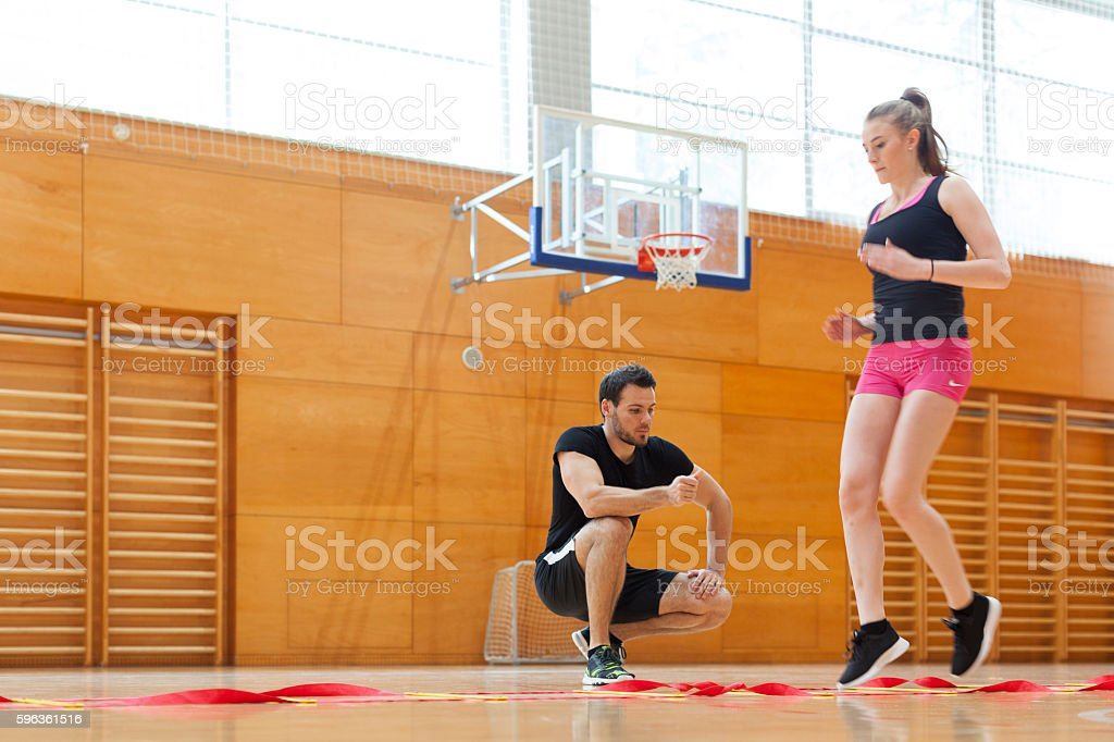 Fitness Trainer Training Young Woman Athlete in Gym royalty-free stock photo