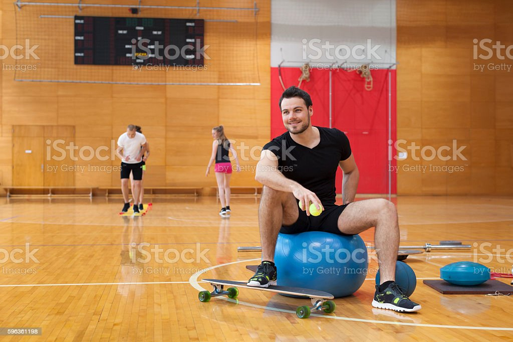 Fitness Trainer with Class Behind Him in Gym royalty-free stock photo